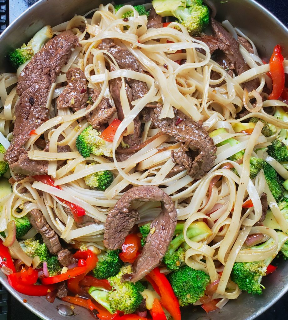 steak and vegetable stir fry with gluten free rice noodles