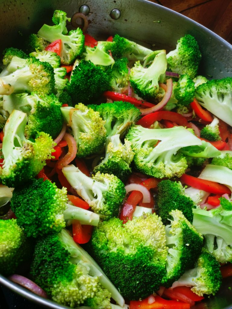saute to cook broccoli, onion and red peppers