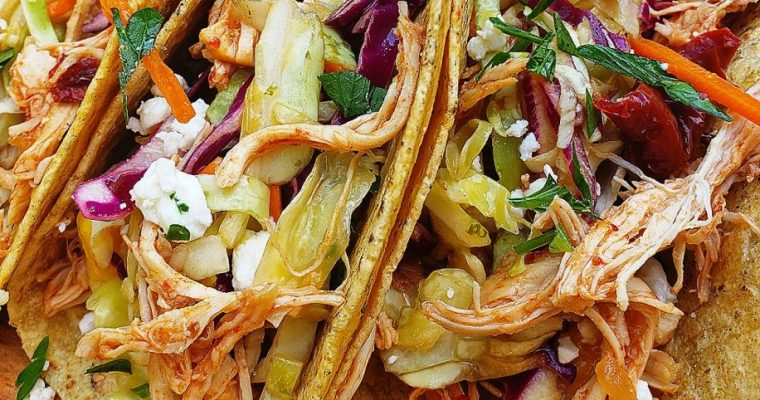 Chipotle Orange Chicken Tacos with Mango-Lime Slaw