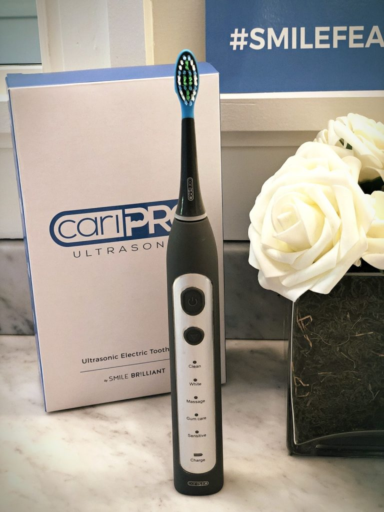 close up of caripro electric toothbrush