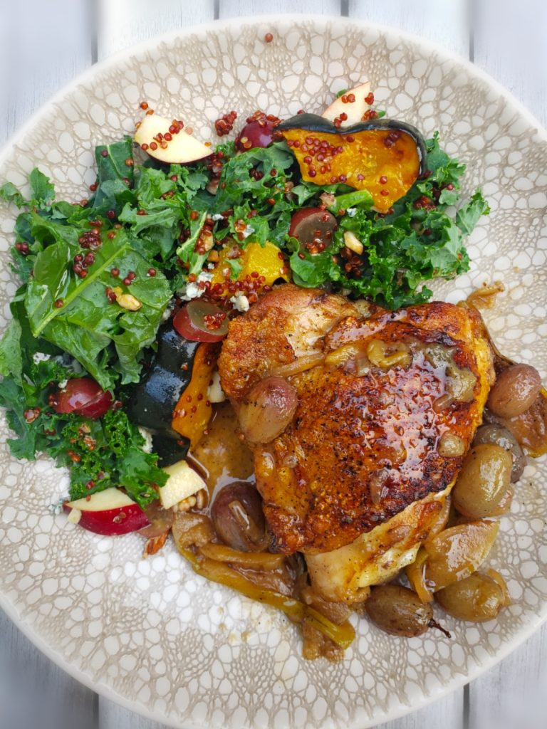 cast iron seared and roasted chicken thigh served with kale salad