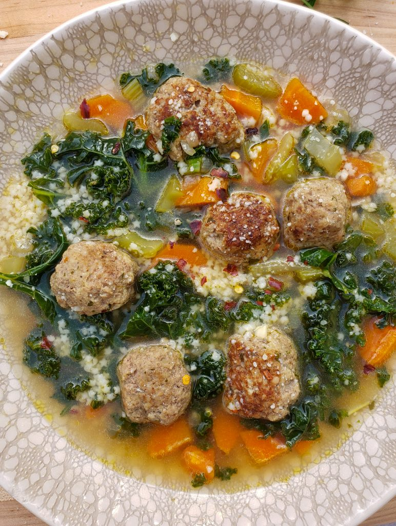 italian wedding soup with meatballs and kale, carrots, celery, chicken broth