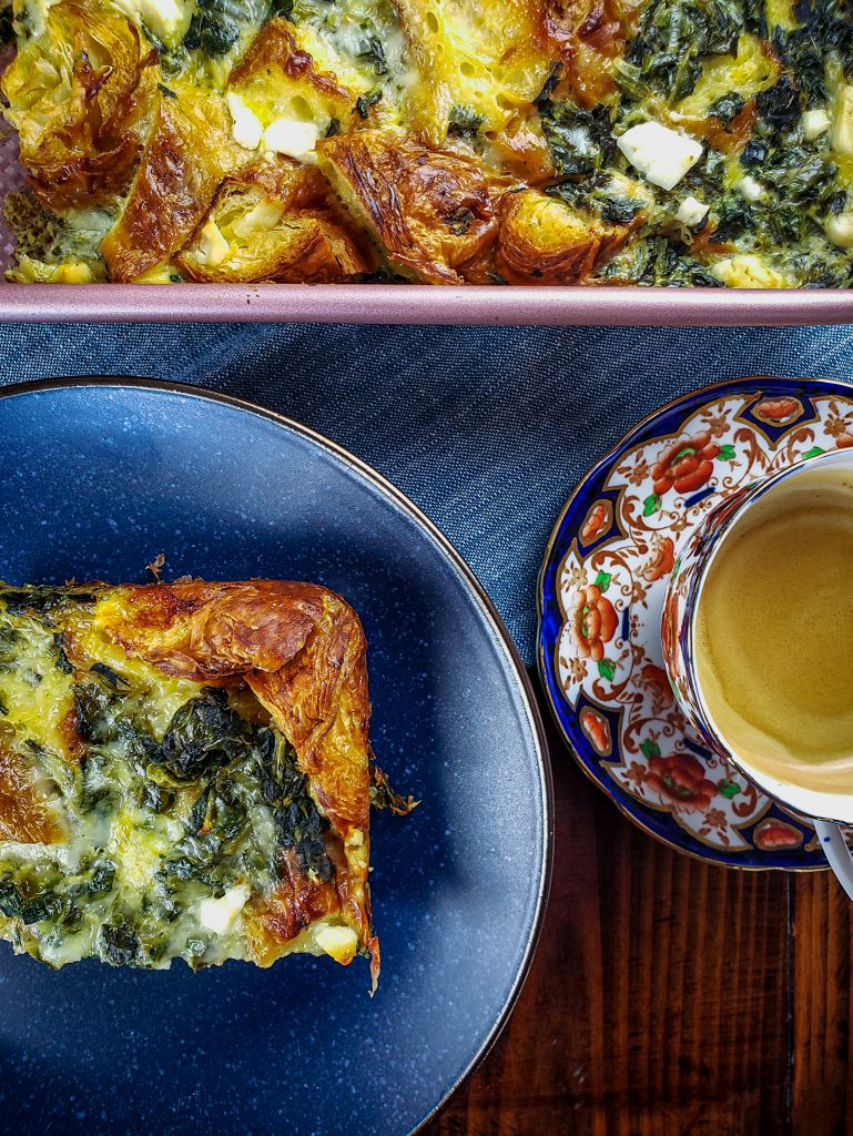 CROISSANT STRATA WITH SPINACH, FETA AND GRUYERE with cup of coffee
