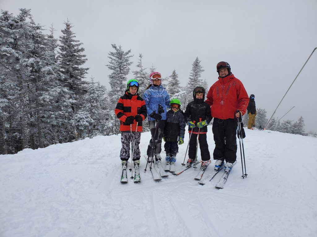 family of five at summit of mountain in sunday rive