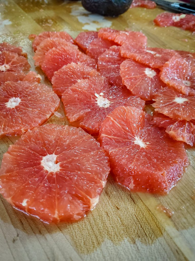 image of peeled and pithed ruby red grapefruit slices