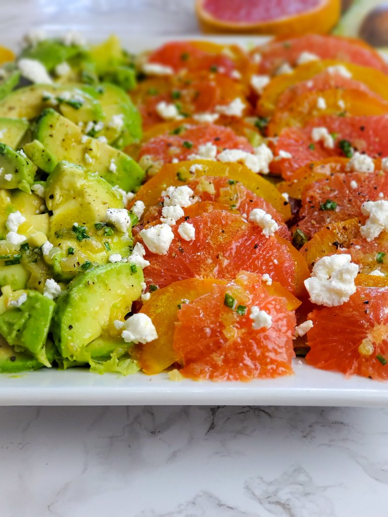 up close image of portion of RED GRAPEFRUIT, GOLDEN BEET AND AVOCADO SALAD