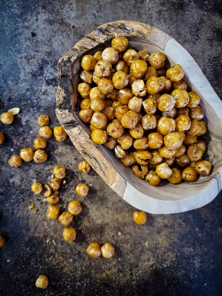 overhead image of wooden bowl of crispy roasted chick peas