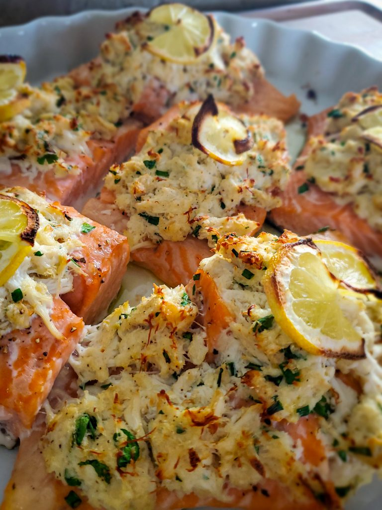 image of crab stuffed baked salmon in baking dish