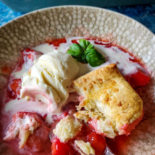 Basil & Bourbon Strawberry Cobbler with Cream Cheese Biscuits